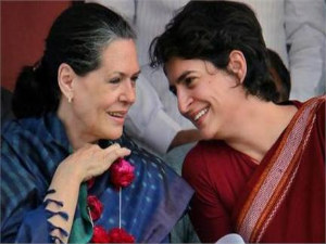 Rae Bareli: Priyanka Gandhi shares a light moment with her mother UPA Chairperson Sonia Gandhi at an election campaign rally .