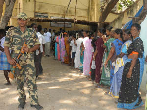 People lined up outside a polling boot to vote in early phase of UP elections