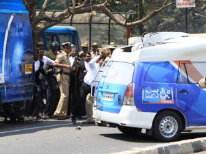 Lawyers attacking a media van
