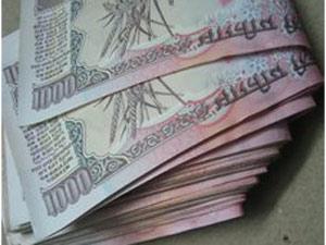 Rupee down 42 paise against dollar