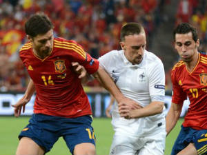Frank Ribery battling for the ball with Spain's Xabi Alonso