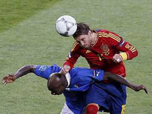 Italy's Mario Balotelli battles for the against Spain's Sergio Ramos