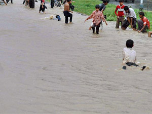 Children playing at river bank