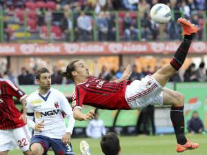 AC Milan striker Zlatan Ibrahimovic tries an overhead kick against Bologna