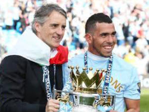 All smiles: Carlos Tevez and Roberto Mancini with the Barclays Premier League trophy