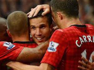 Chelsea on top, Man Utd earn first win