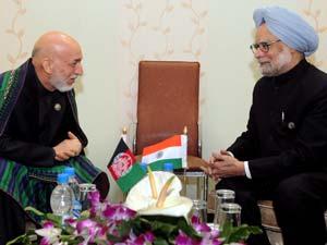 Singh meets Afghan Prez, Syrian PM