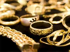 Gold sheds Rs 50, slips from record high