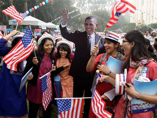 Barack Obama supporters celebrate victory in New Delhi