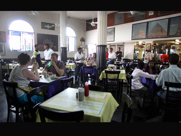 Life is back: View of famous Leopold Cafe in Mumbai