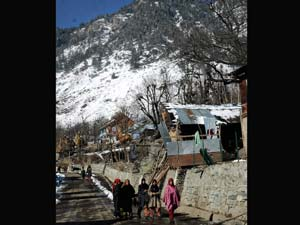 Girls walk towards school at Pahalgam