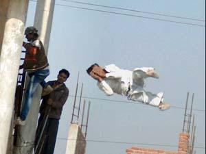 Man Jumps Off a Water Tank