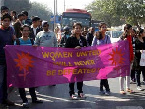 JNU students holding a banner