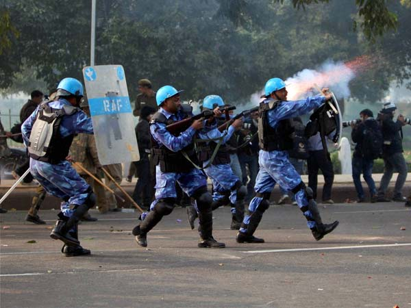 RAF personnel fire tear gas shells