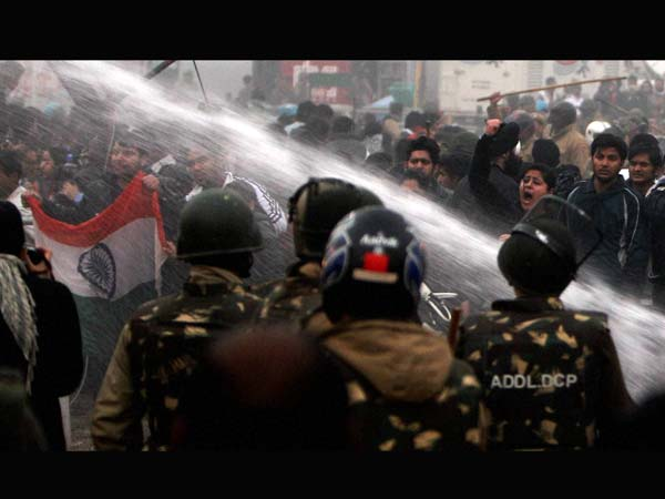 Police use water cannons on protesters