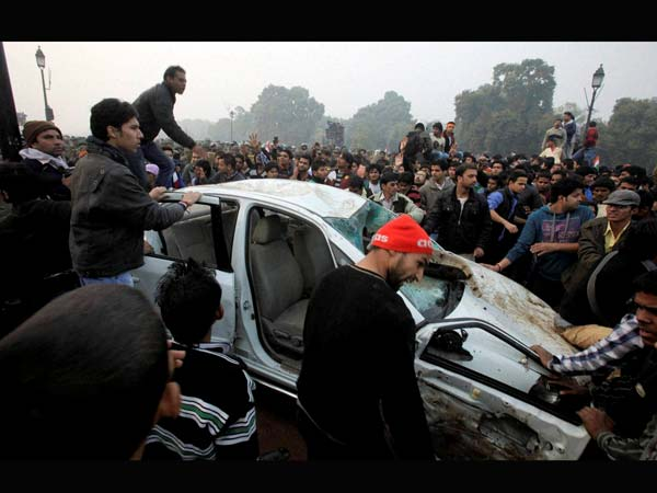 Protesters damage a government vehicle