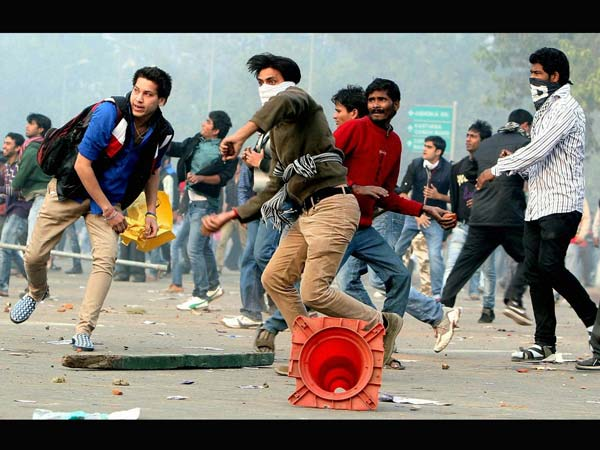 Protesters pelt stones towards police