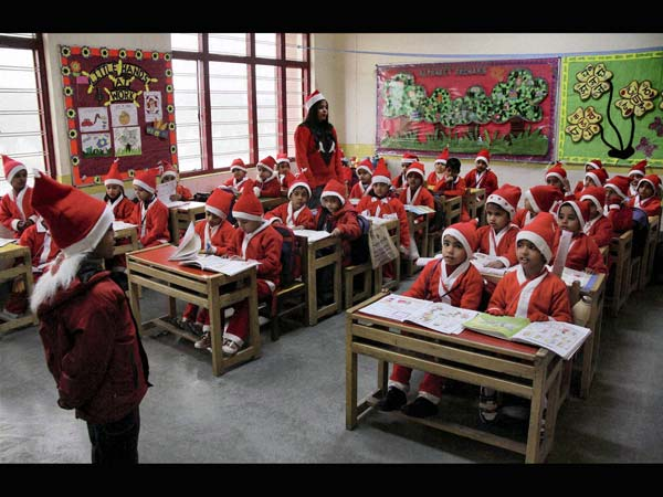 Christmas celebration: The Santas in school