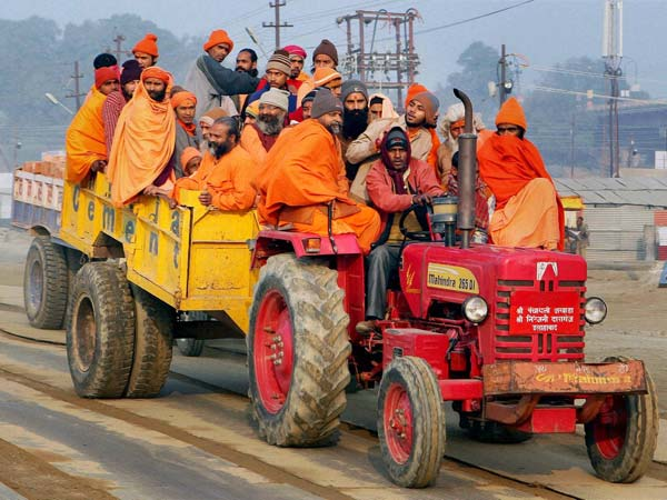 Sadhus arrive by a tractor at Sangam
