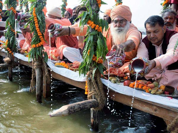 Akhada Sadhus or holy men perform Ganga Puja