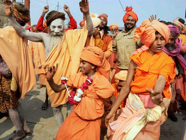 Sadhus dance during a flag raising ceremony