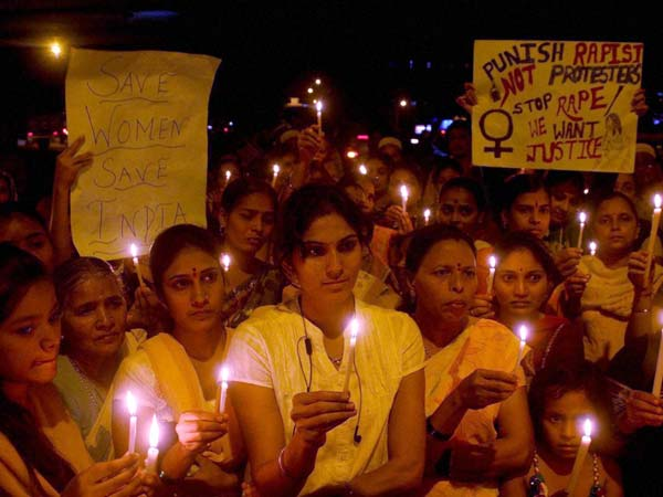 People Take part in Candle Light