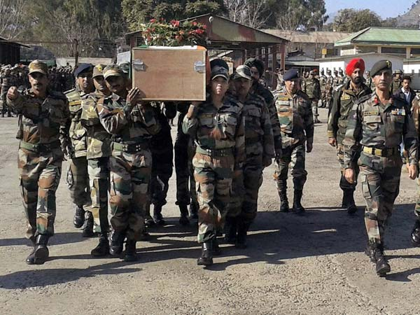 Army Soldiers Carry a Coffin