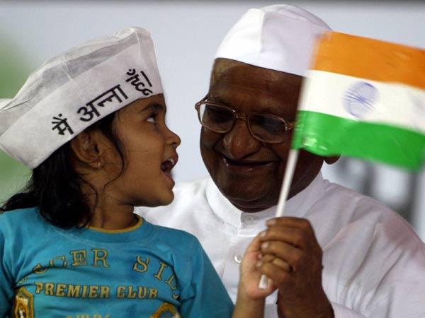 Anna Hazare holding a kid