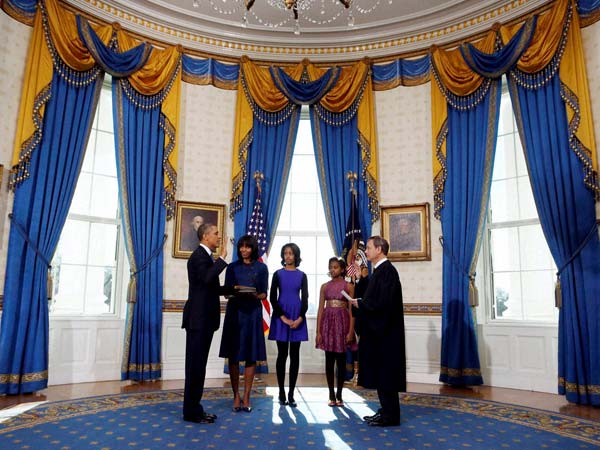 Barack Obama is officially sworn-in by Chief Justice John Roberts in the Blue Room