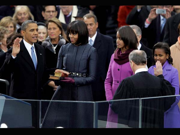 Barack Obama receives the oath of office from Chief Justice John Roberts