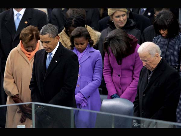 Barack Obama and Vice President Joe Biden listen to the benediction