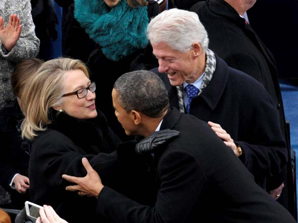 Barack Obama is greeted by Secretary of State Hillary Clinton