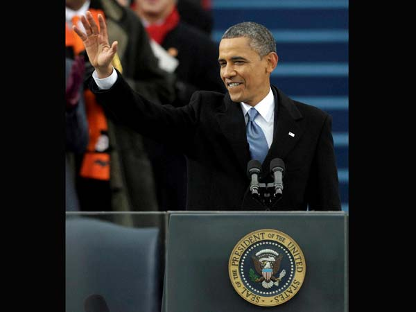 Barack Obama waves after his ceremonial swearing-in