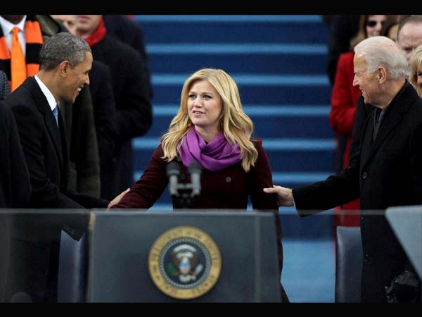Singer Kelly Clarkson is greeted by President Barack Obama