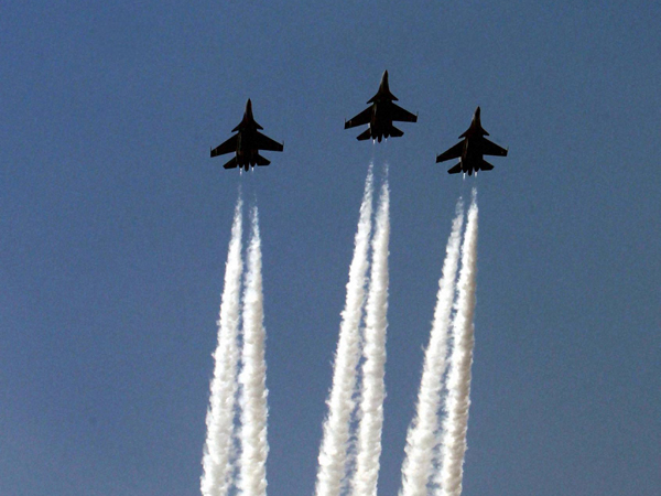 Air force fighter jets present a fly