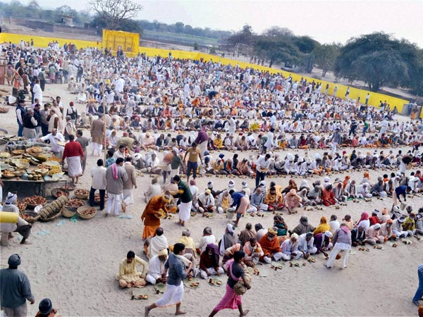 Devotees at a mass lunch organised by a trustee