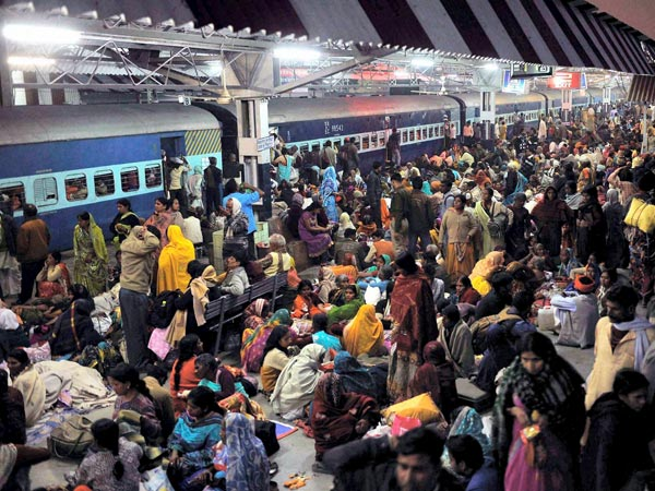 Devotees waiting for trains at Allahabad railway station