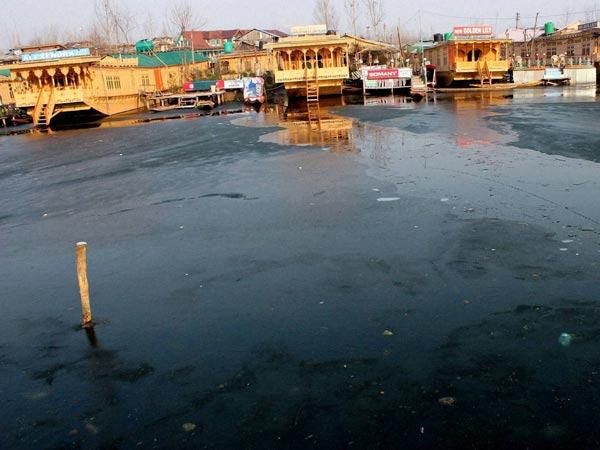 Houseboats seen at the frozen Dal Lake