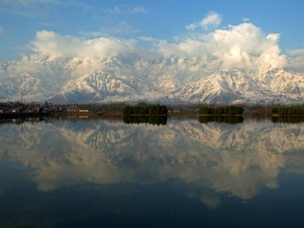 Reflection of a snow covered picturesque mountain