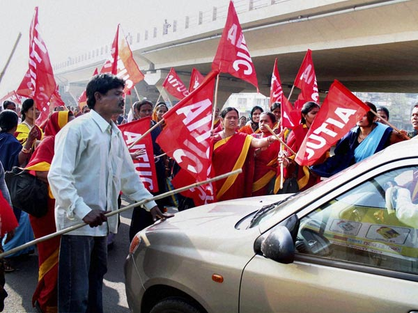 Activists try to stop a vehicle on the day of 'Bharat Bandh'