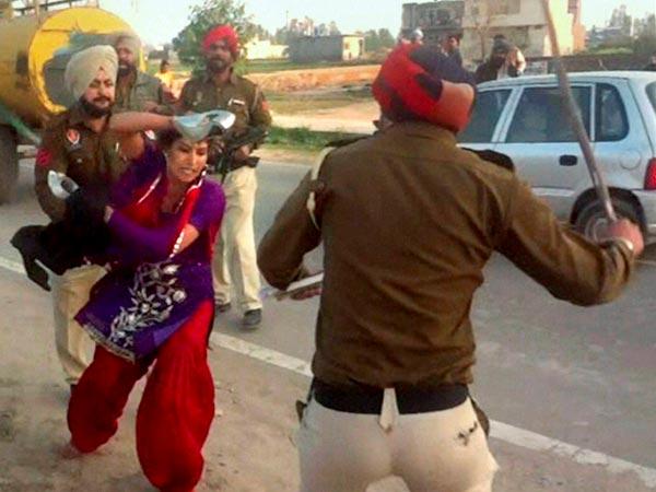 Cops beat Woman