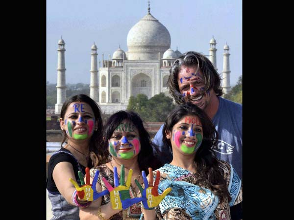Foreigners enjoying Holi