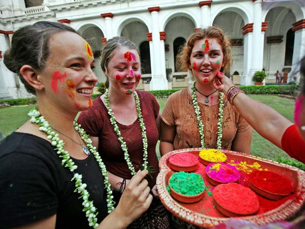 Foreigners gets a taste of Holi
