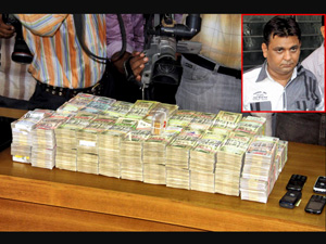 Guj: Bookie held, Rs 1.28 cr,gold seized