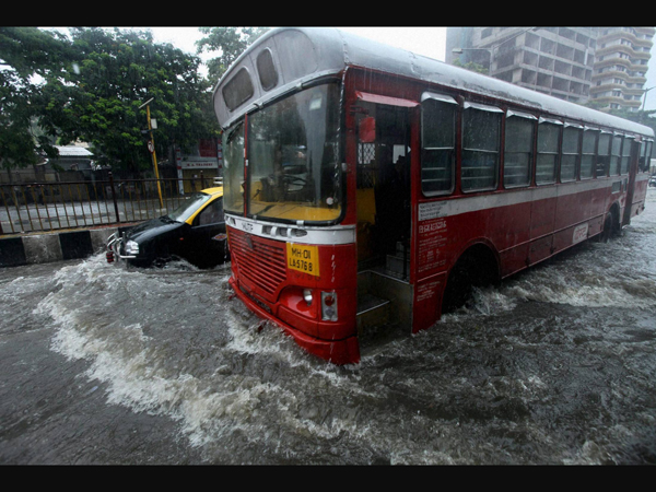 monsoon cripples life in mumbai Heavy rains in mumbai crippled normal life on tuesday the heavy down pour accompanied by gusty winds since last evening led to traffic snarls at various places suburban trains were also running late due to water logging on the tracks several low lying areas including king's circle, sion, andheri.