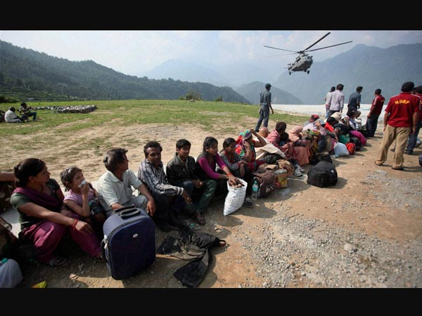pilgrims-wait-for-helicopter
