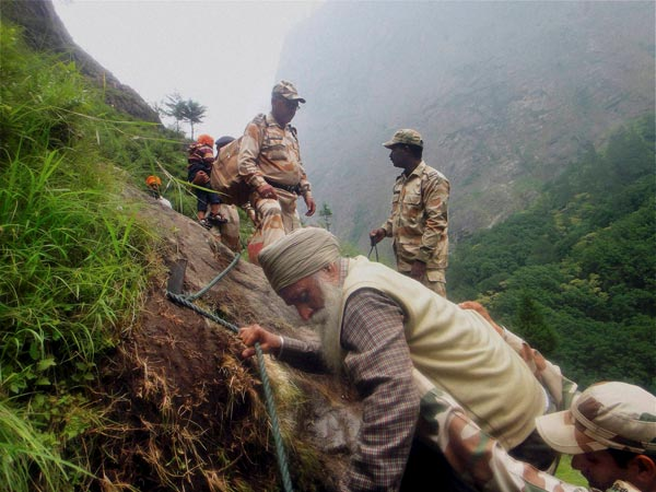 ITBP personnel rescuing stranded pilgrims at flood hit Govindghat