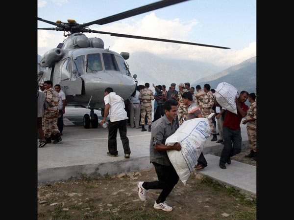 Indian Air Force personnel unloading relief material