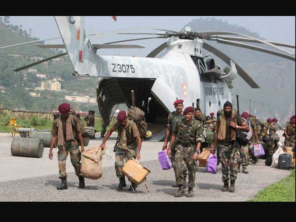 Army men carrying relief material