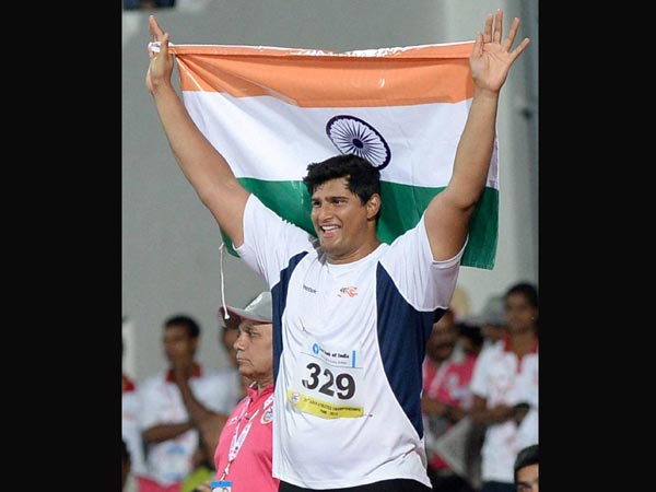 Vikas Gowda with the Tri-colour Indian Flag